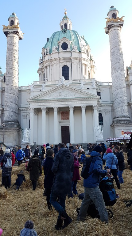 Karlsplatz-Christmas-market-Vienna-hay-filled-play-area-in-front-of-Karlskirche-church.jpg